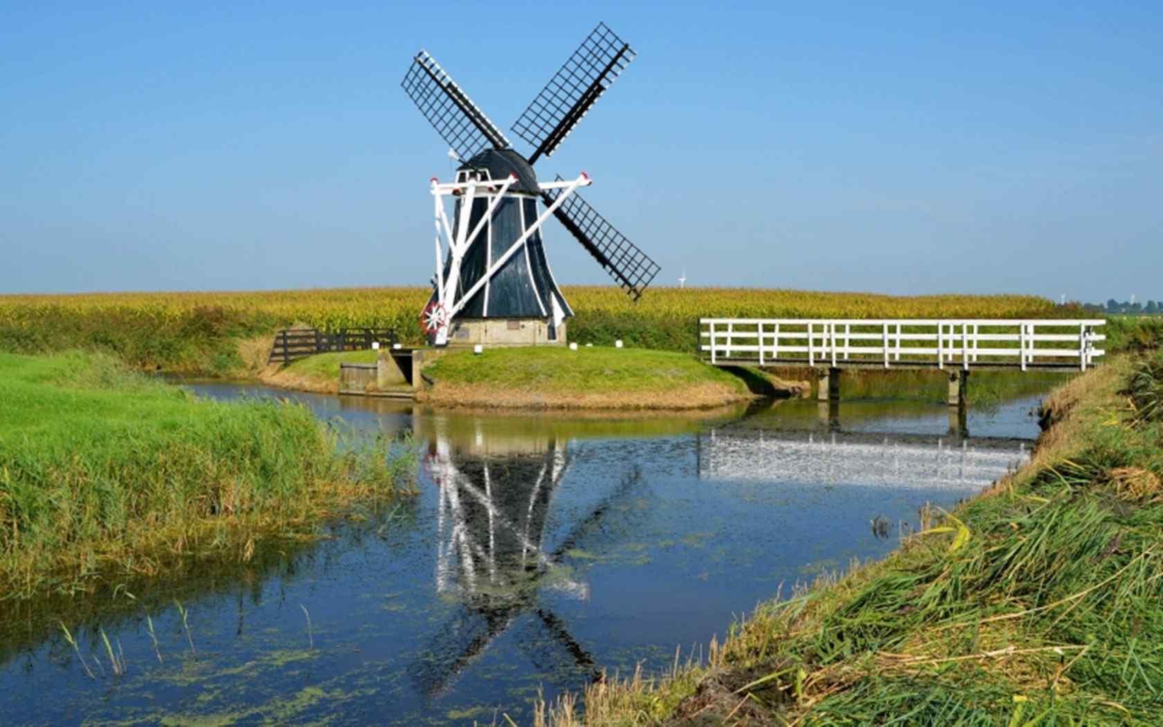 荷兰风车高清壁纸 风车图片 旋转的风车