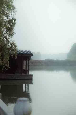 江南水乡之清晨迷雾中的乌镇古镇手机壁纸