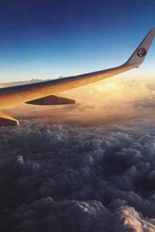 漫步云端在飞机上看日出手机壁纸
