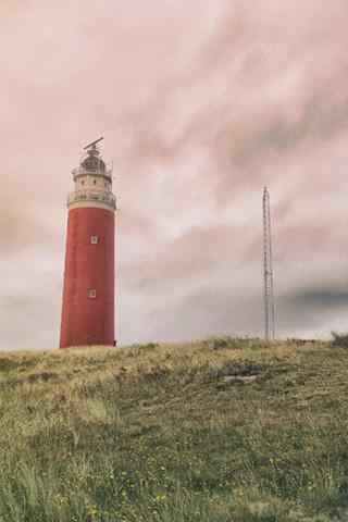 暖色调荷兰唯美灯塔风景手机壁纸