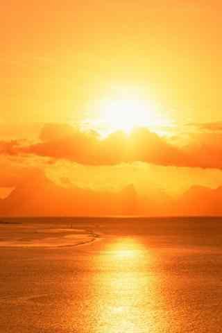 耀眼的海边晚霞风景手机壁纸