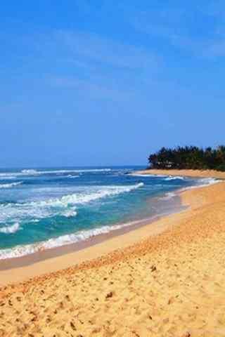 唯美沙滩边的海浪风景手机壁纸