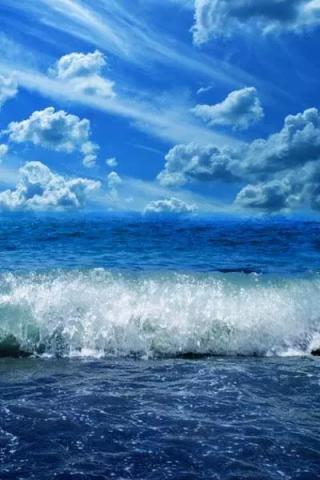 蓝天下的海浪图片手机壁纸
