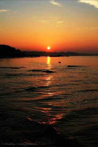 落日下的北戴河海