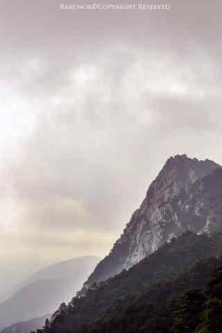 唯美夕阳下庐山山峰手机壁纸