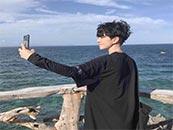 帅气小哥哥在海边的自拍超清头像图片