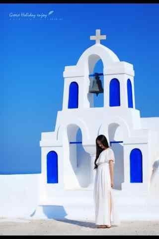 圣托里尼蓝白色经典建筑下美女美拍图片手机壁纸