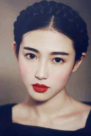 精致发型的文艺美女红唇图片手机壁纸