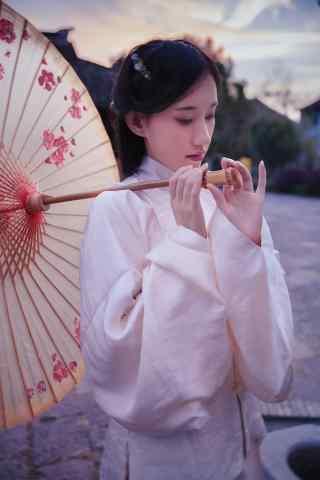 汉服褙子—余辉照在少女脸庞上手机壁纸