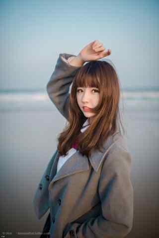 JK制服—海边漂亮的小姐姐手机壁纸