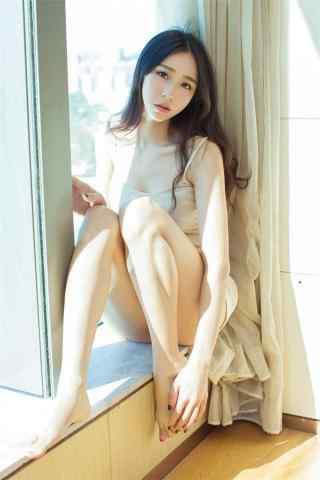 清(qing)純少(shao)女長腿寫真(zhen)手機壁紙