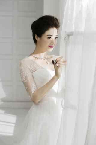 美女蒋欣纯洁唯美婚纱写真图片手机壁纸
