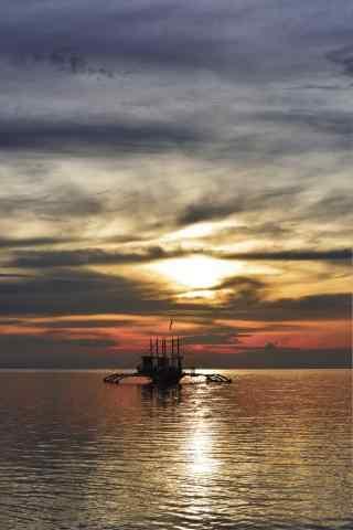 夕阳下的长滩岛风景手机壁纸