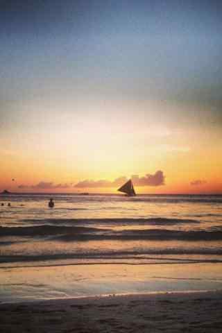 长滩岛黄昏风景帆船手机壁纸