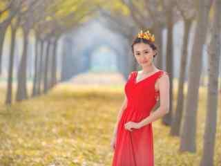 银杏林中的红衣美女写真壁纸