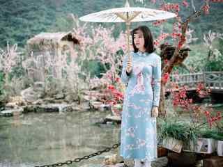 旗袍—游园里面的少女桌面壁纸