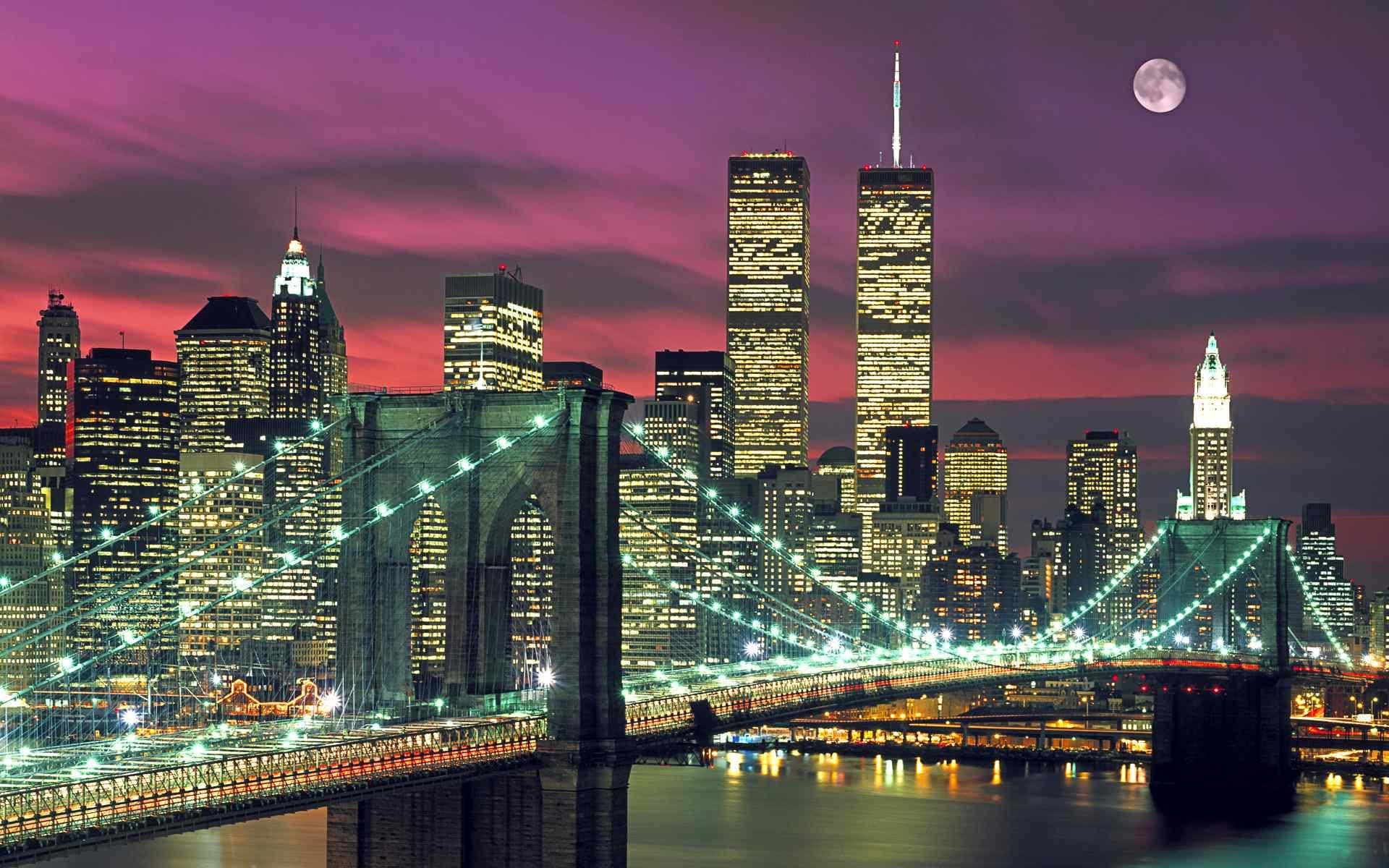 繁华城市夜空中的月亮图片桌面壁纸