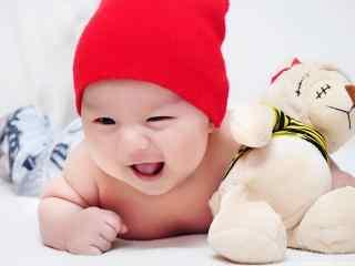 甜美微笑的可爱宝宝桌面壁纸