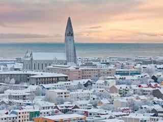 冰岛首都雷克雅未克唯美日出雪景图桌面壁纸