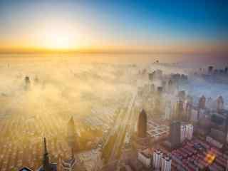 晨雾中唯美的城市风景图片桌面壁纸