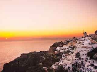 圣托里尼唯美海边粉色日出图片高清桌面壁纸